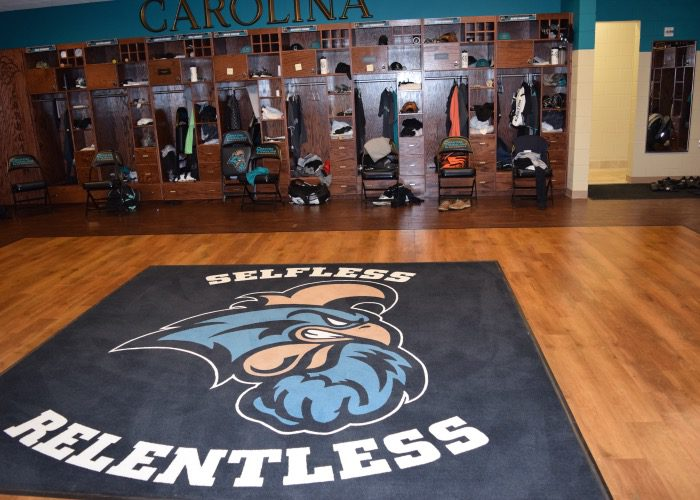 "Borrowed from Michigan football, the Chanticleers created a ""sacred space"" using this rug in the heart of the locker room. Only Gary Gilmore is allowed in the space, but he'll invite players to celebrate with him there after big wins (Aaron Fitt)"