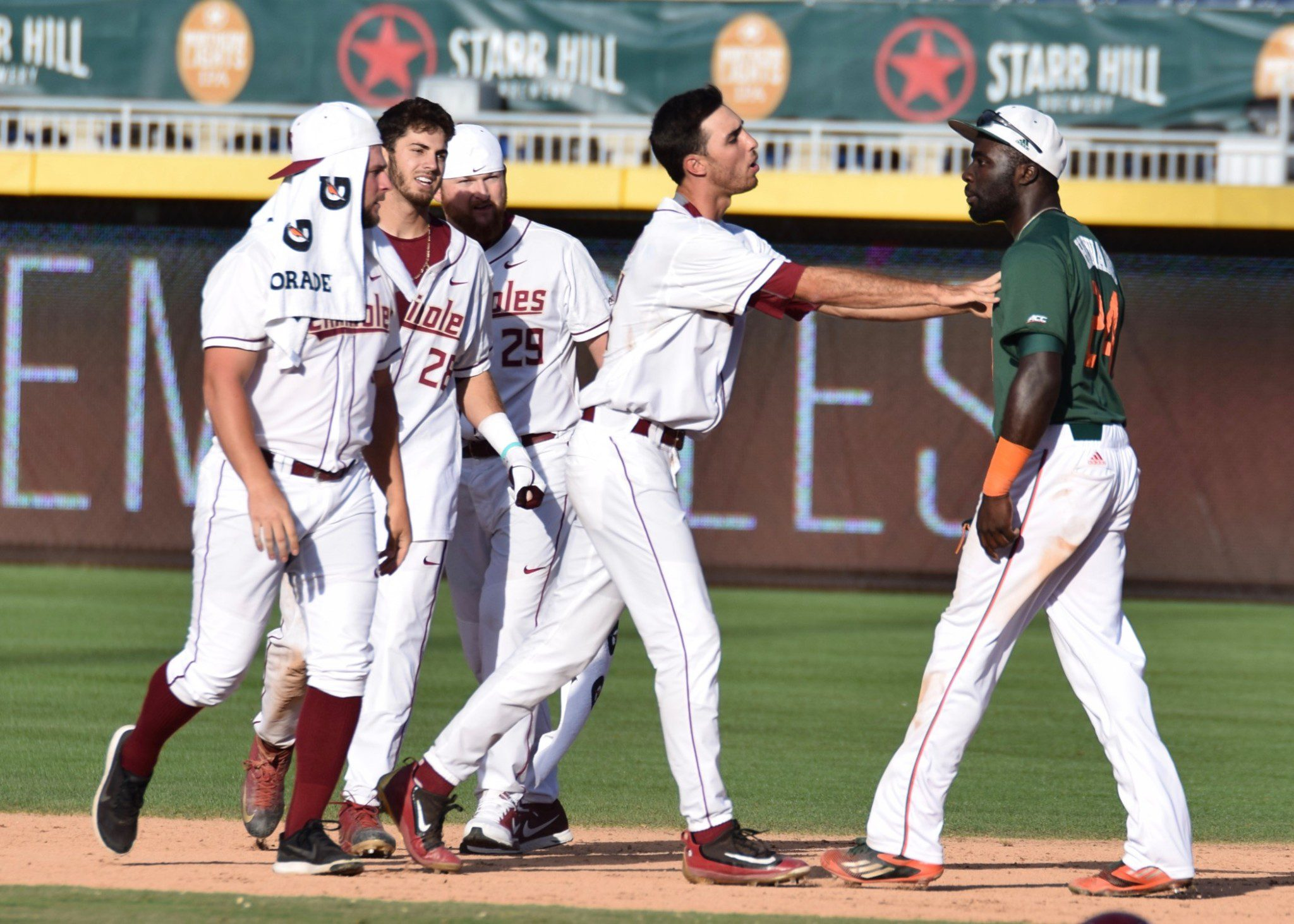 Miami's Jacob Heyward exchanges words with some Florida State players (Aaron Fitt)