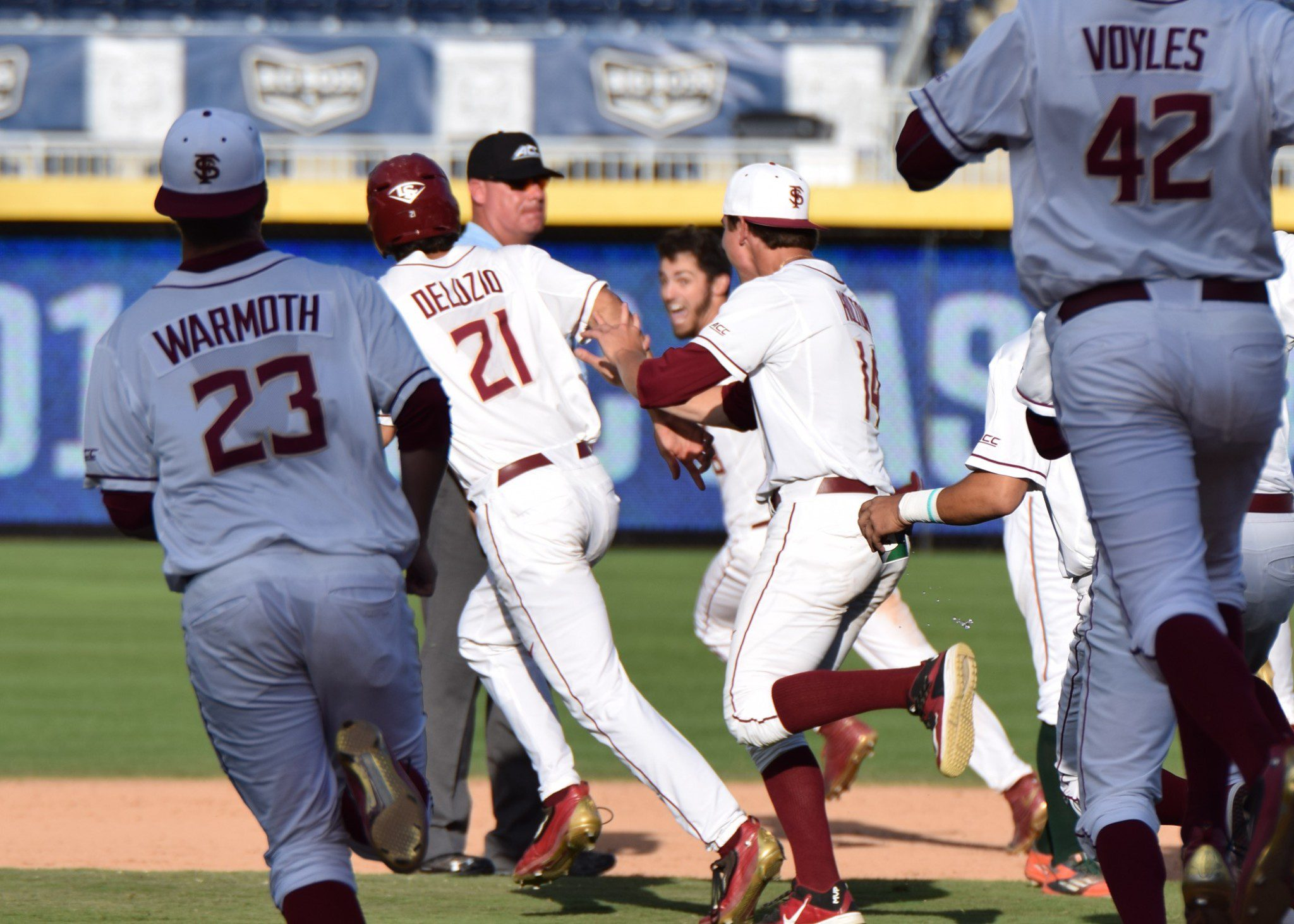 Florida State players try to mob Dylan Busby after his walk-off hit (Aaron Fitt)