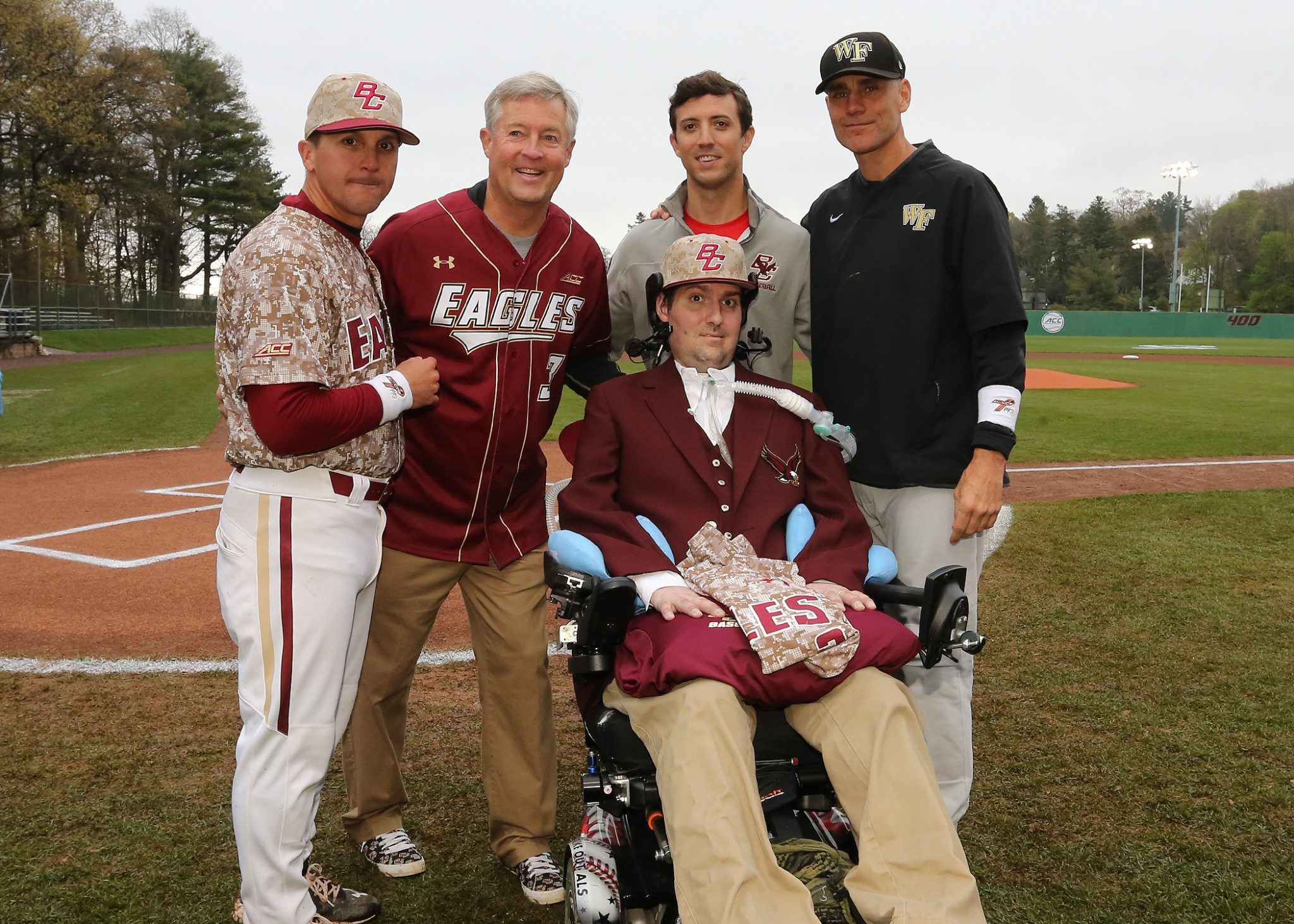 Pete Frates with BC coach Mike Gambino, his father John and brother Andrew, and Wake Forest coach Tom Walter (John Quackenbos/BC Athletics)