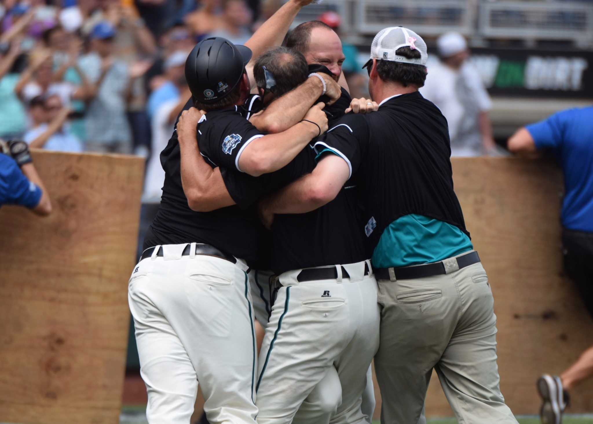 Coastal Carolina's coaching staff envelopes Gary Gilmore in a giant group hug (Aaron Fitt)