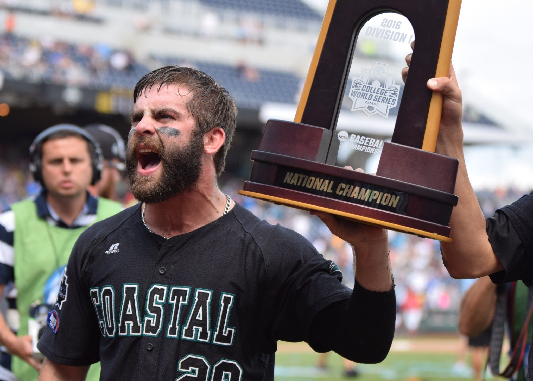 Coastal Carolina's Anthony Marks hoists the national championship trophy (Aaron Fitt)