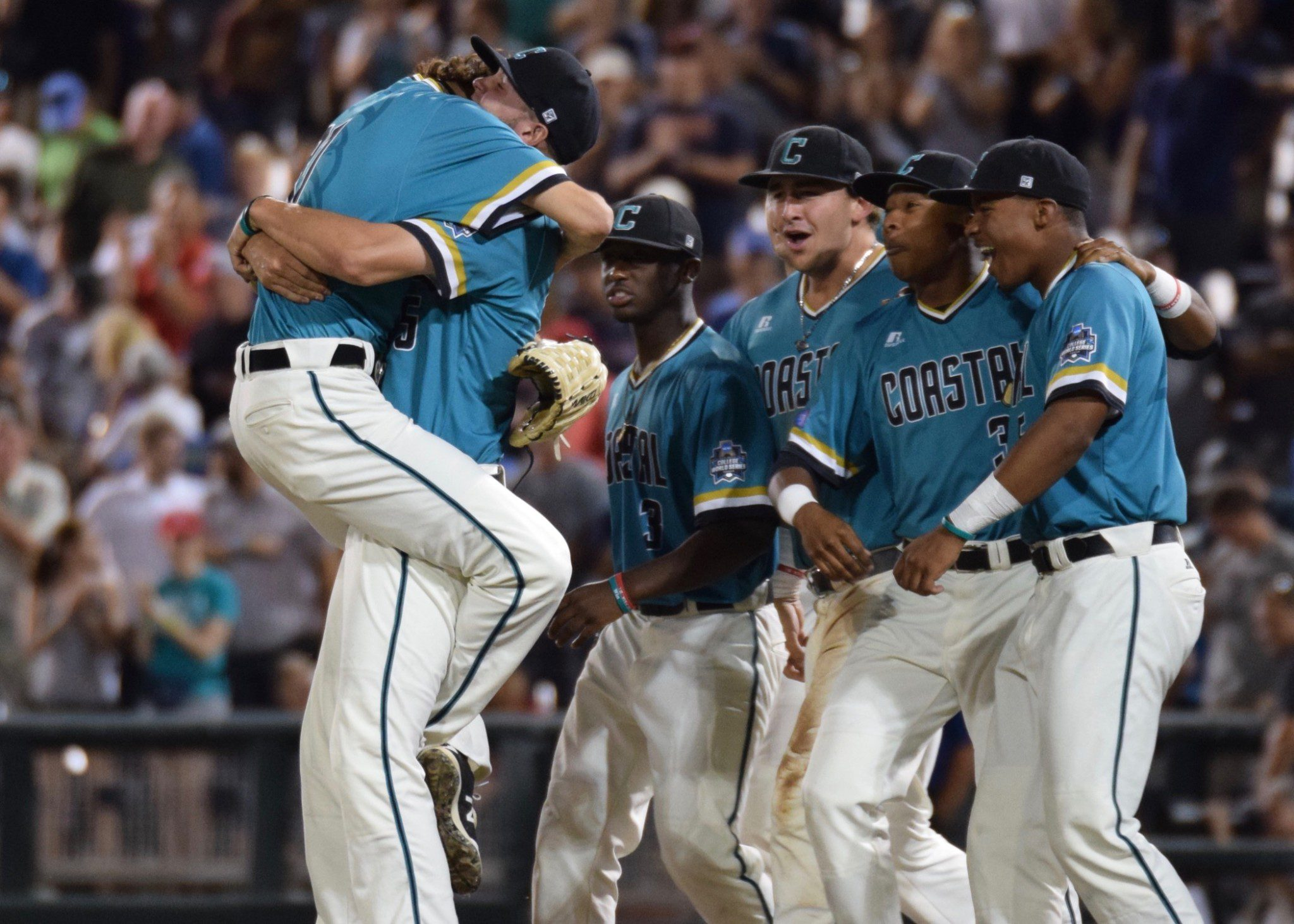 Coastal Carolina reliever Bobby Holmes leaps into Mike Morrison's arms after Tuesday's 5-4 win (Aaron Fitt)
