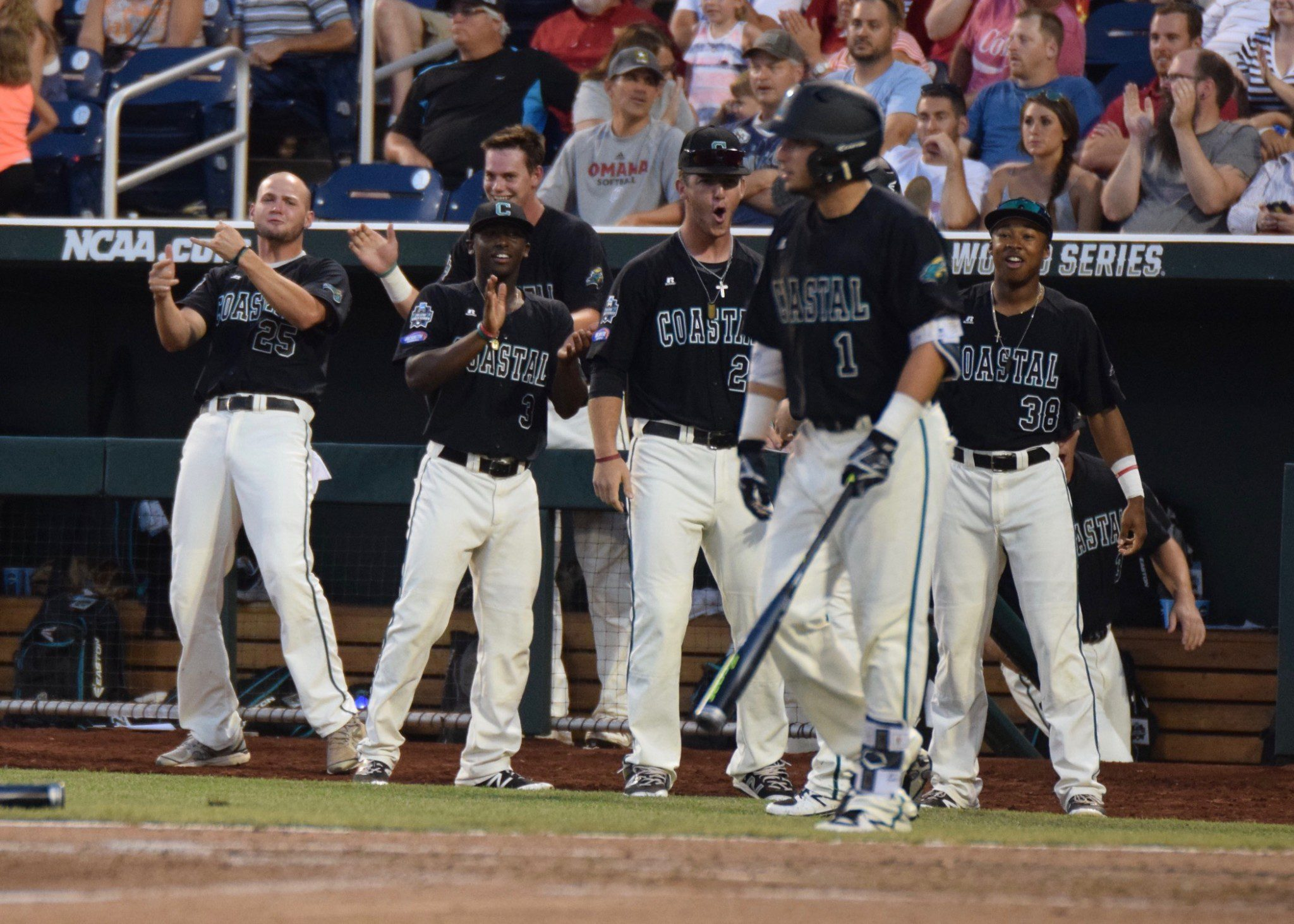 Coastal Carolina players celebrate during a seventh-inning rally Friday against TCU (Aaron Fitt)