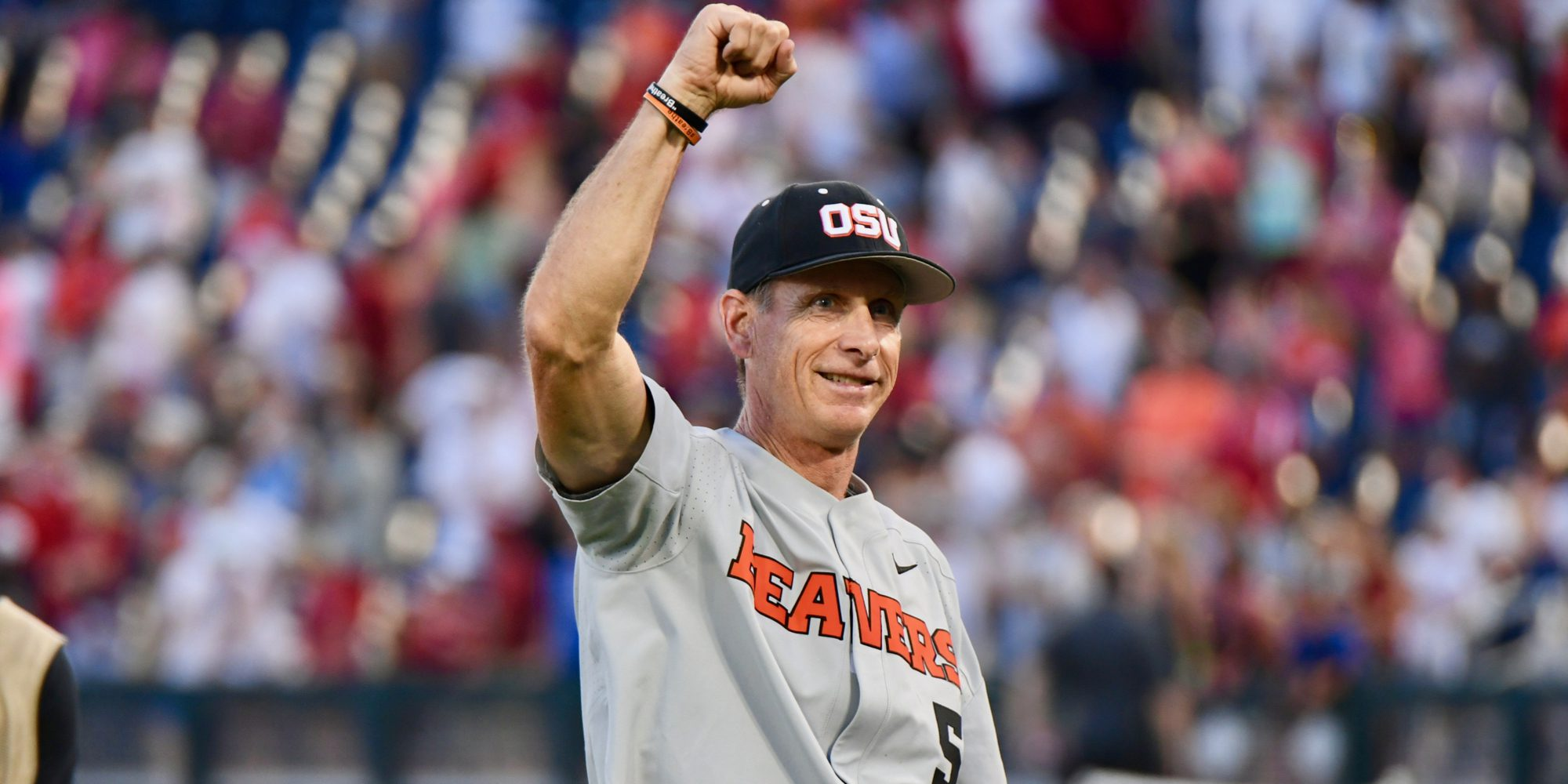 Oregon State coach Pat Casey salutes fans after winning his third title
